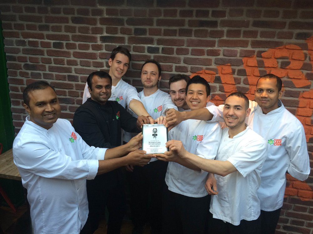 Roman poses for a kitchen team photo after Curry Leaf Cafe won 'Best Newcomer' at the 2015 Celebration of Sussex Life Awards. Pictured far left is Head Chef Gouranga Bera, next to him is Chef/Co-owner Kanthi Thamma.