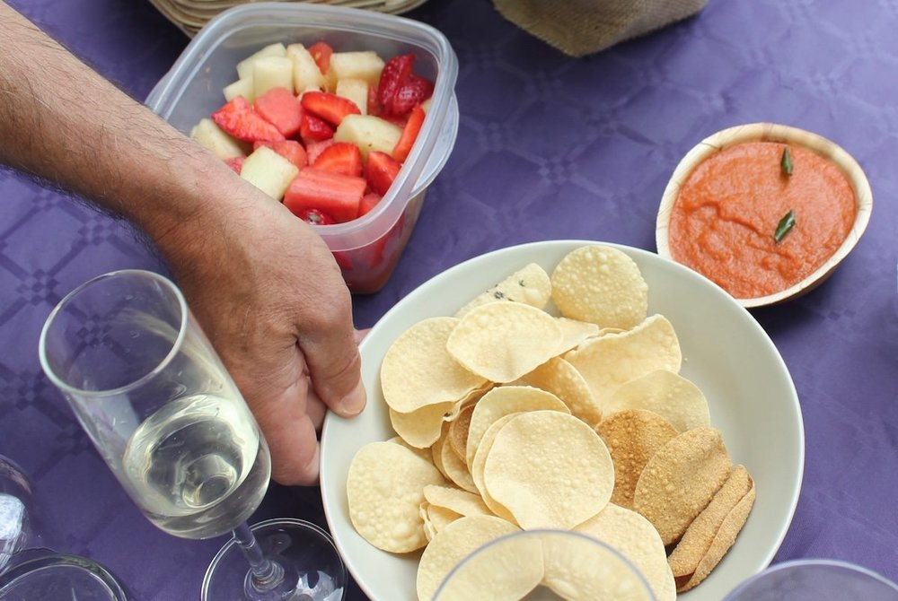 Poppadums, chutneys and fruit chaat masala were among the nibbles served