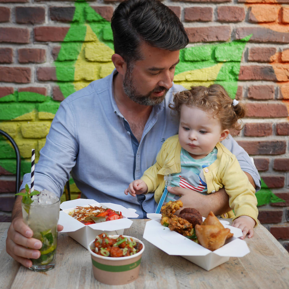 Co-founder Euan lunches at the Brighton Lanes Cafe with his 18-month-old daughter Astrid