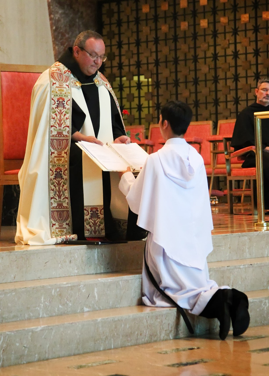 Fr. Bernie Scianna, O.S.A. receives first vows of a young novice.