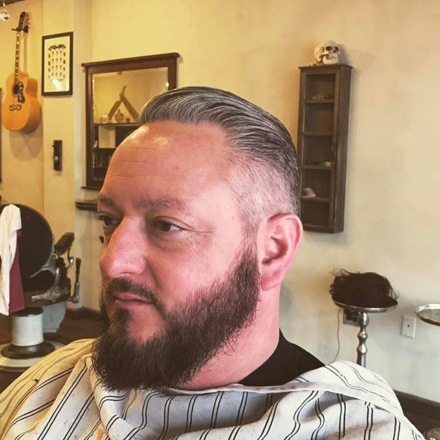Fun and classic haircut! Styled with our Glass Pomade #virile #heartandheritage #barber