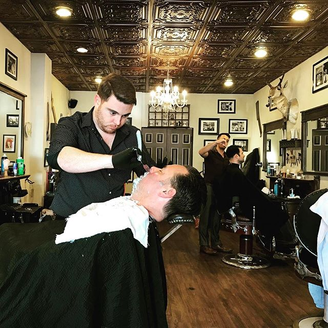 Shaking off the winter chill this weekend with a hot towel shave! 😏 #virile #heartandheritage #barber