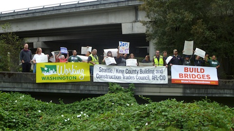 Working Washington holds banners above 520