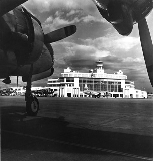 Sea-Tac Tarmac and Terminal with Plane in foreground 1950