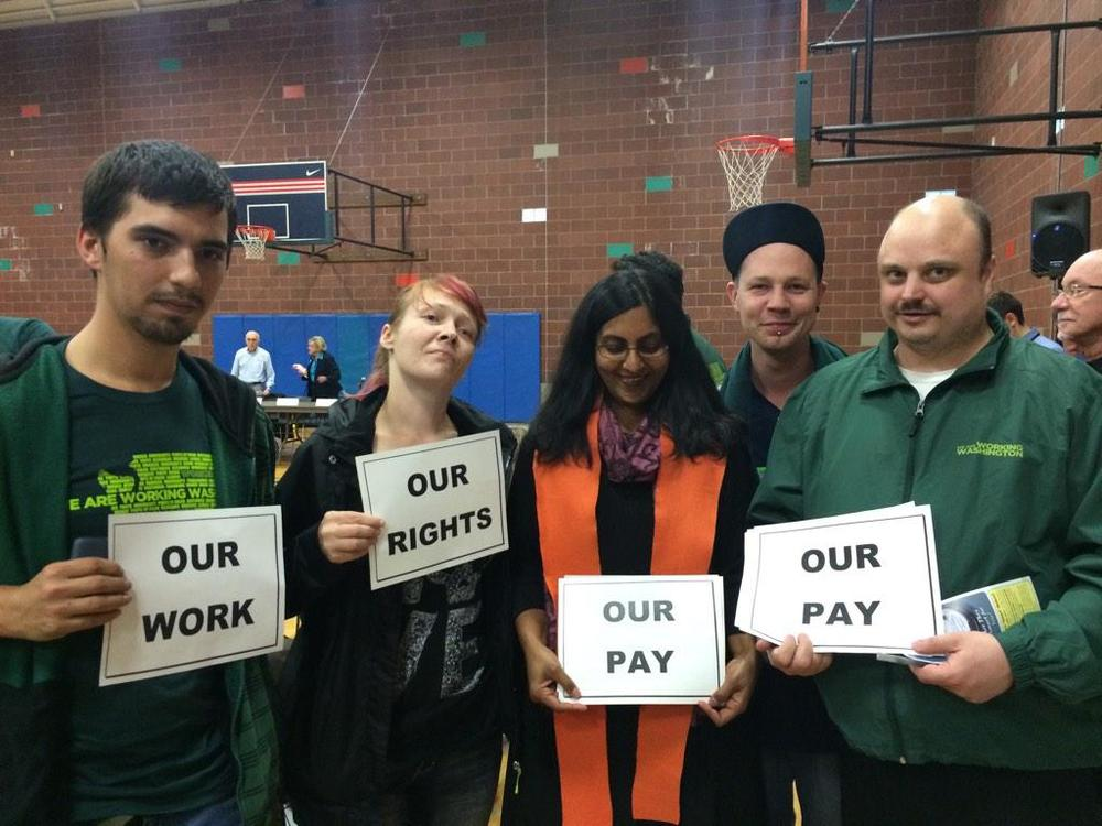 Councilmember Kshama Sawant with fast food workers before the hearing, supporting strong enforcement of $15.