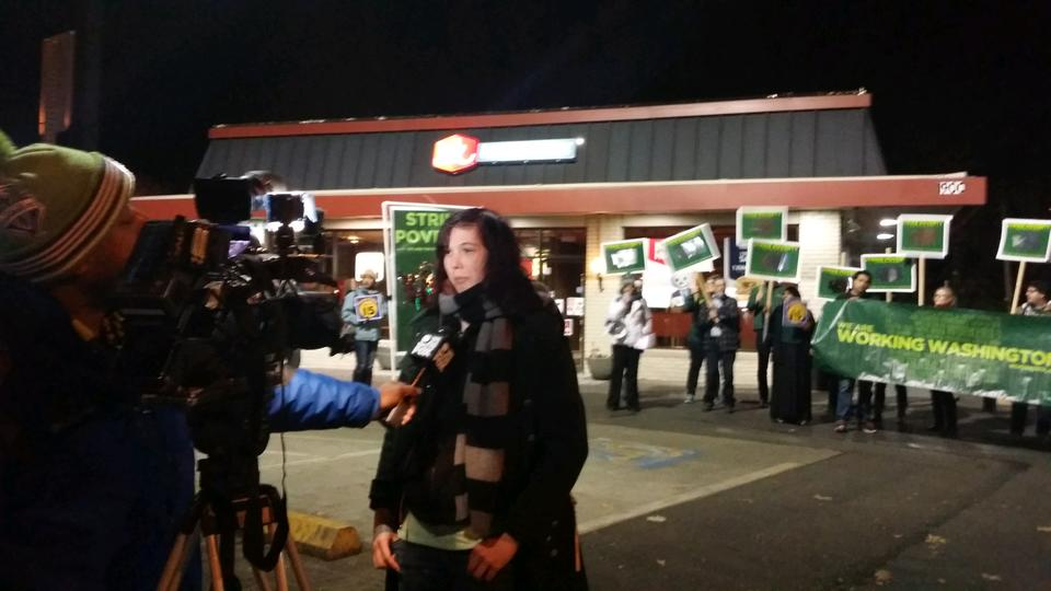 Lucy talks to the media about why she's on strike for $15 today.