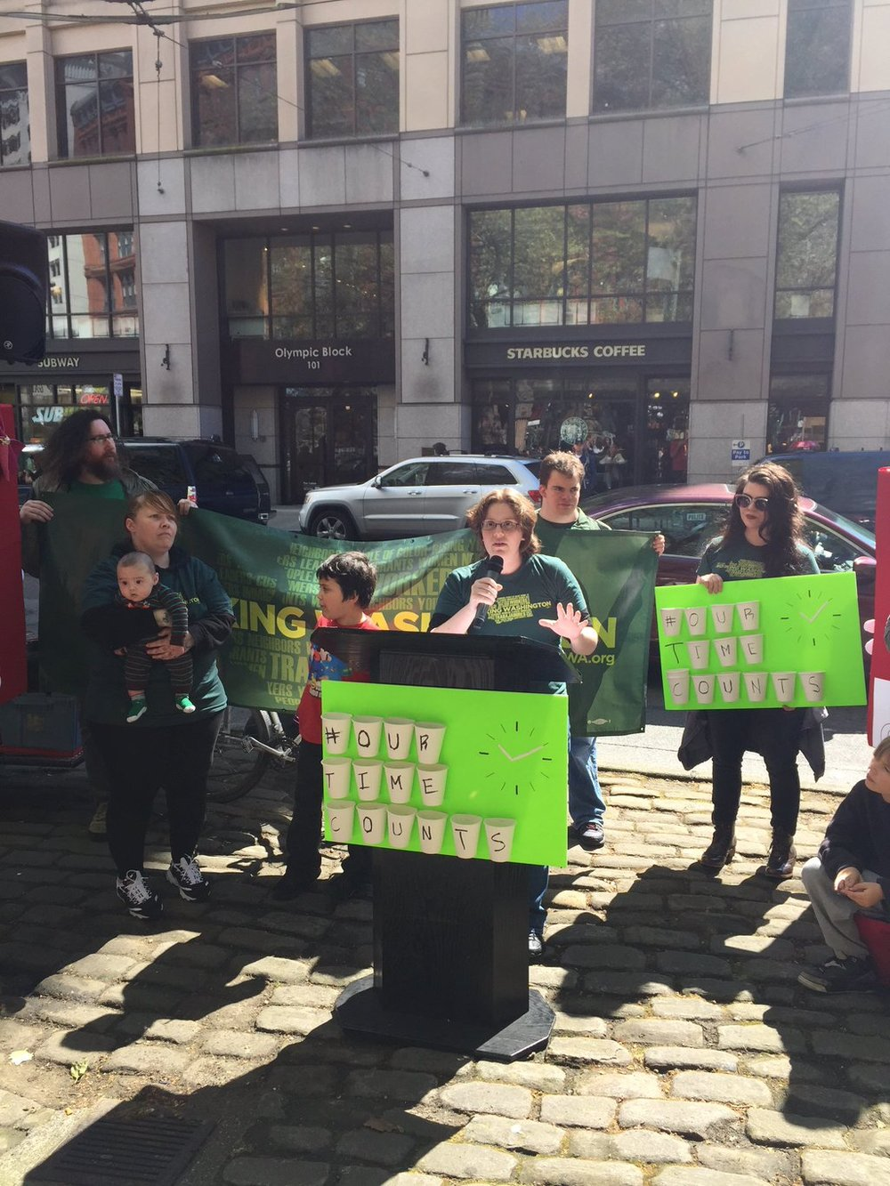 April 14, 2016: Starbucks barista Ilana Greenberg addresses rally for secure scheduling outside downtown Seattle Starbucks store.