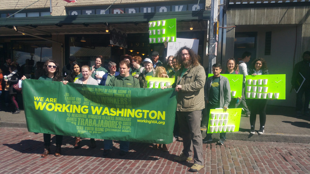 "April 14, 2016: Rally for secure scheduling outside ""Original Starbucks"" in Pike Place Market, Seattle."