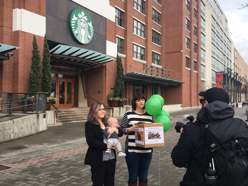 Above: Jess Svabenik, a barista from Gig Harbor, and Kristen Piccolo, a barista from Ohio, deliver tens of thousands of petitions to Starbucks Headquarters calling on the company to make their paid leave policy more equitable.