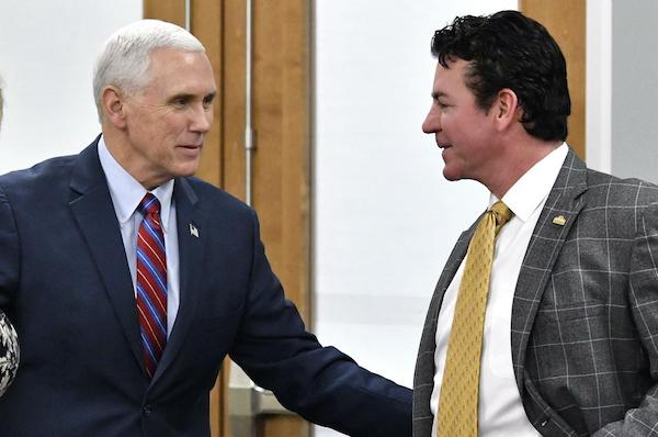 Above: Papa John's outgoing CEO with Vice President Mike Pence, in 2017.