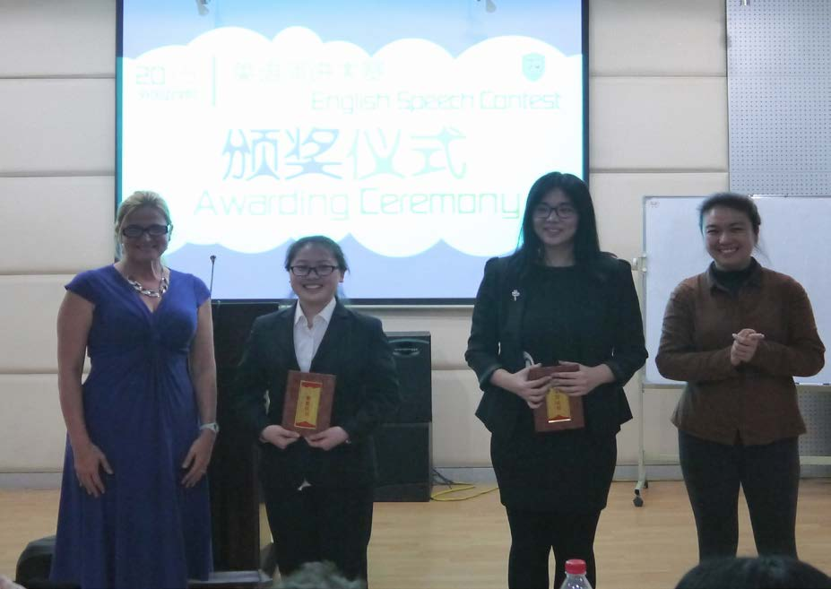 Two NEU students attending the English Speech Contest Award Ceremony at Guangzhou University