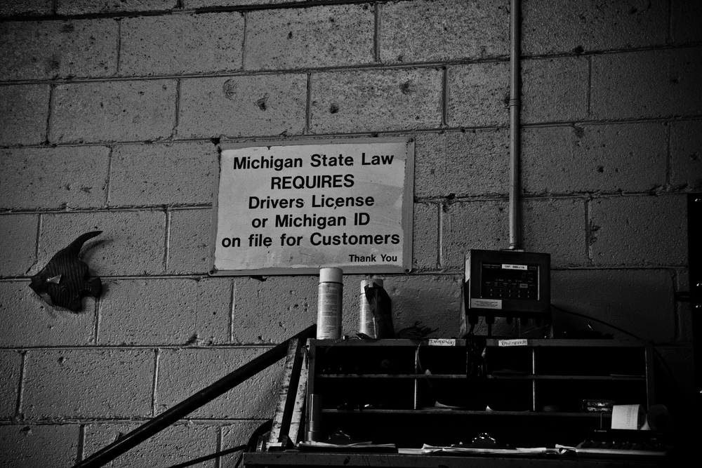 Signs decorate the loading scales to ensure those scrapping metal understand the strict policies. H&H Metals, Detroit.
