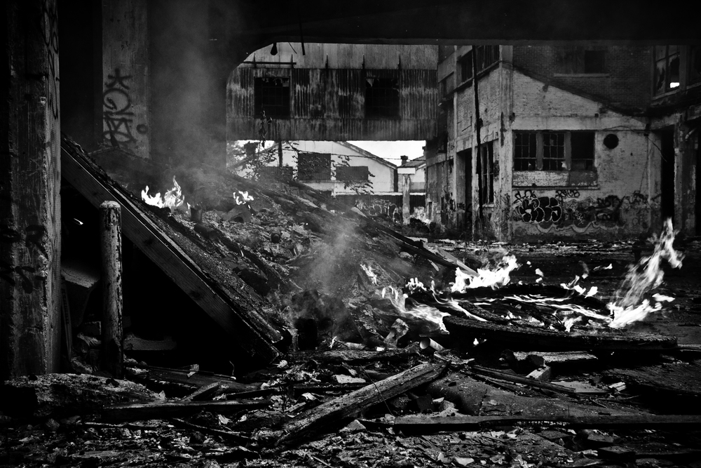 Fires litter the streets and  abandoned structures of Detroit. Many are the result of scrappers who utilize them to melt the coatings on the metal they obtain. Packard Plant, Detroit.