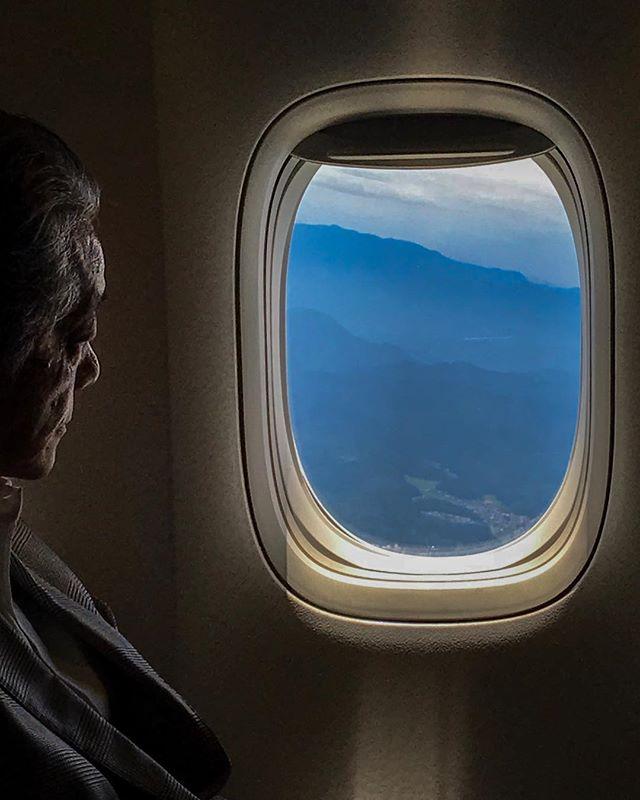 Bored on a plane... Take off. ———————————————— A man looks out the window to the Hakusan Mountain Range. ————————————————— Komatsu Airport. Kanazawa, Ishikawa, Japan ———————————————— www.bradpatocka.com ———————————————— #Japan #Kanazawa #plane #komatsu  #hakusanmountains #takeoff #onassignment #work #mountains #landscape#westjapan #framing #thatlighttho #windows #documentary #iphone #exlpore #travel