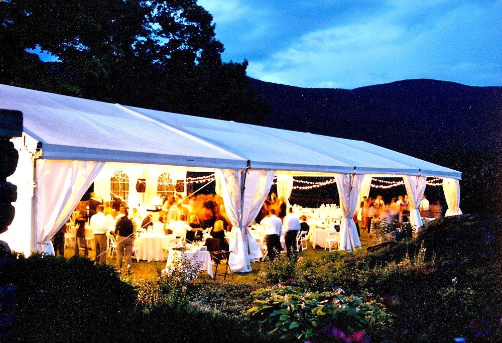 A tented wedding set under the mountains.