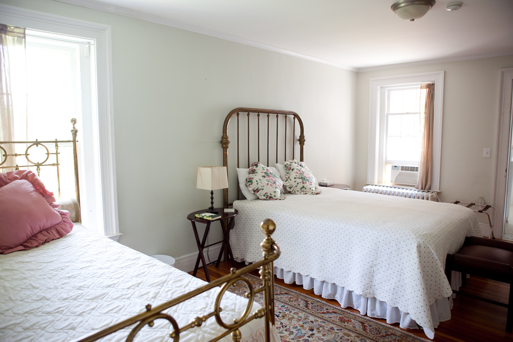 Bedroom 3,This large room has a twin and double brass bed and non-working fireplace and big built in bookshelf,266 sq. ft..