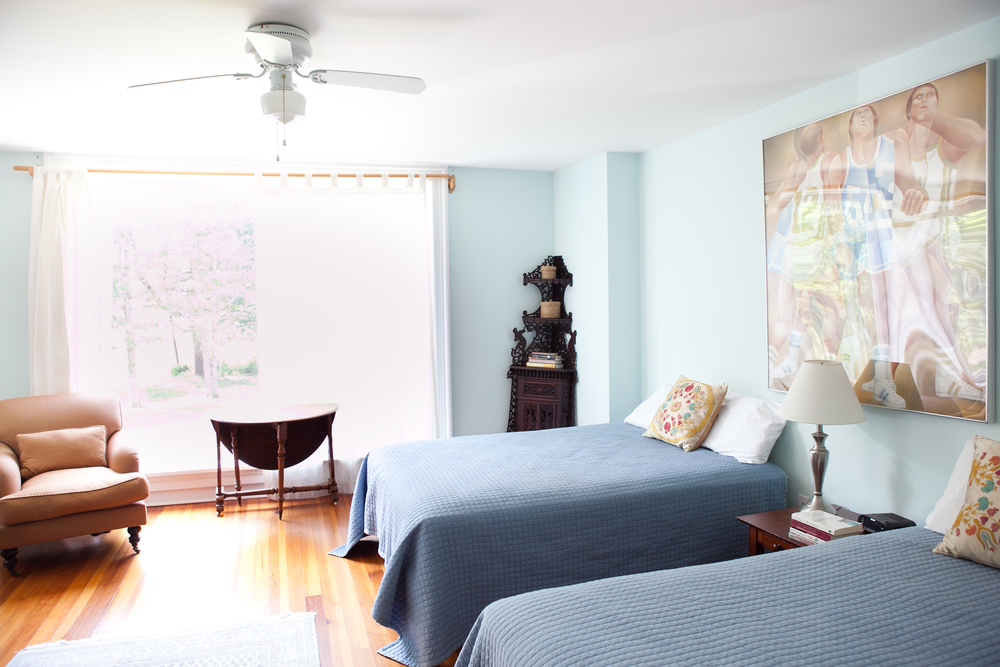 Room 4 is an airy blue bedroom with 2 double beds and a shower, 300 sq. ft.,