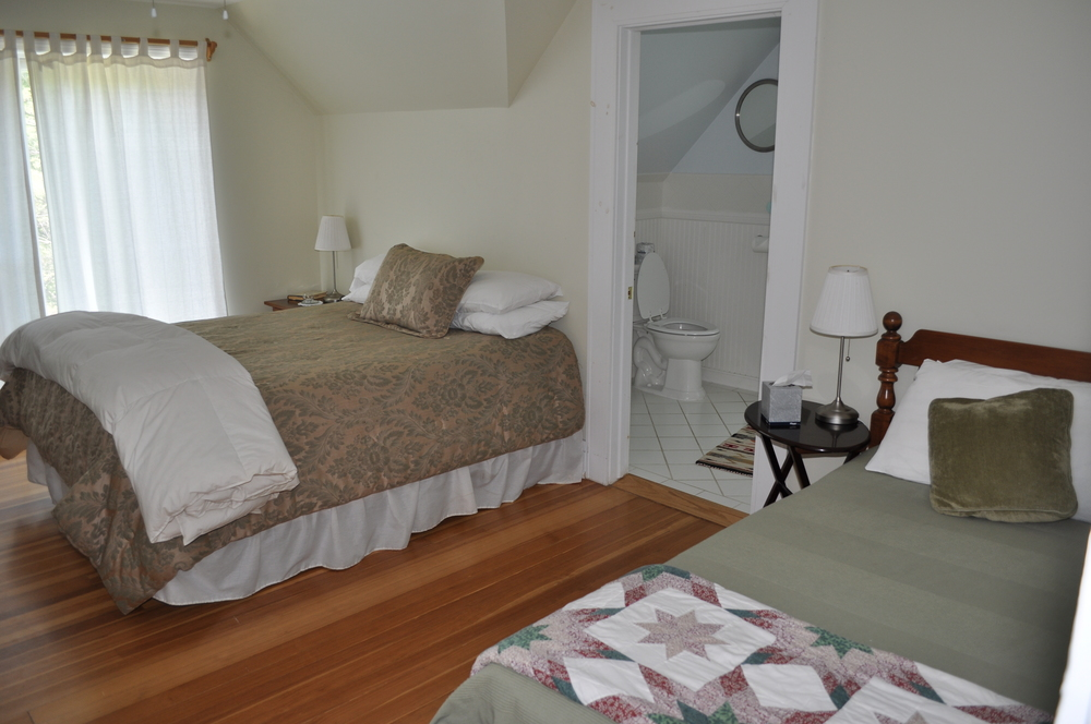 Room 6 features a double and a twin bed and a bathroom with a tub,  190 sq ft.