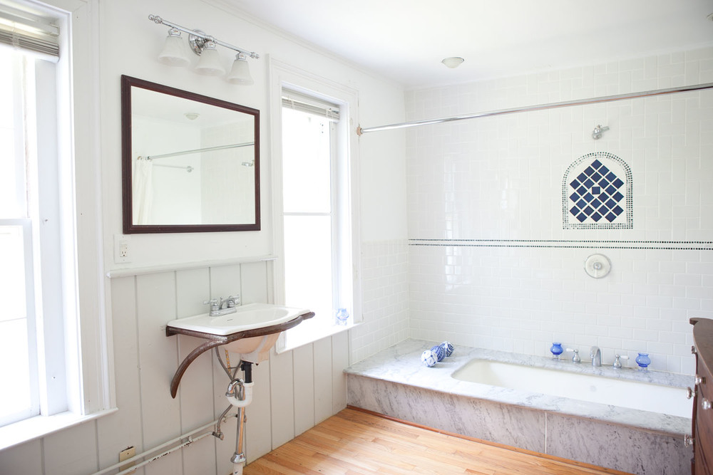 Room 1 bath marble tub.jpg