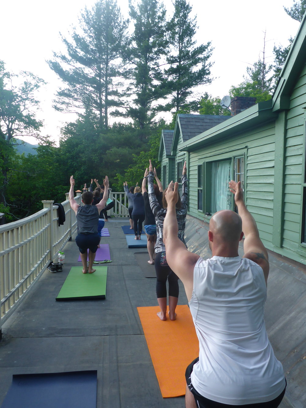 yoga arms outstreatched roof.JPG