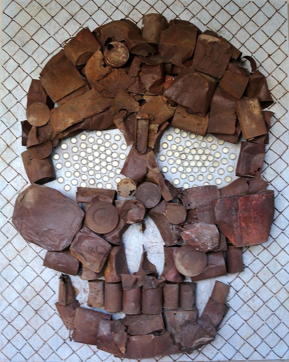 """Rabbit Hole , metal cans, nails, bottle caps, wood, paint, 48x60"""", 2015."""