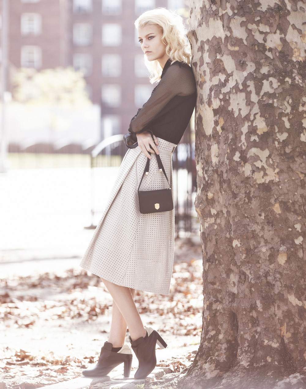 Sarah Fraser   (Wilhelmina)  wears a dress, bag and shoes by Osklen and skirt by Zara.