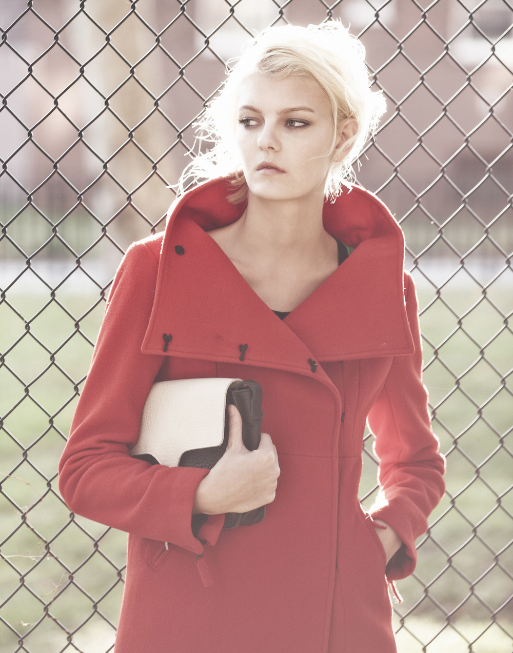 Sarah Fraser   (Wilhelmina)  wears a coat, shirt and bag by Osklen.