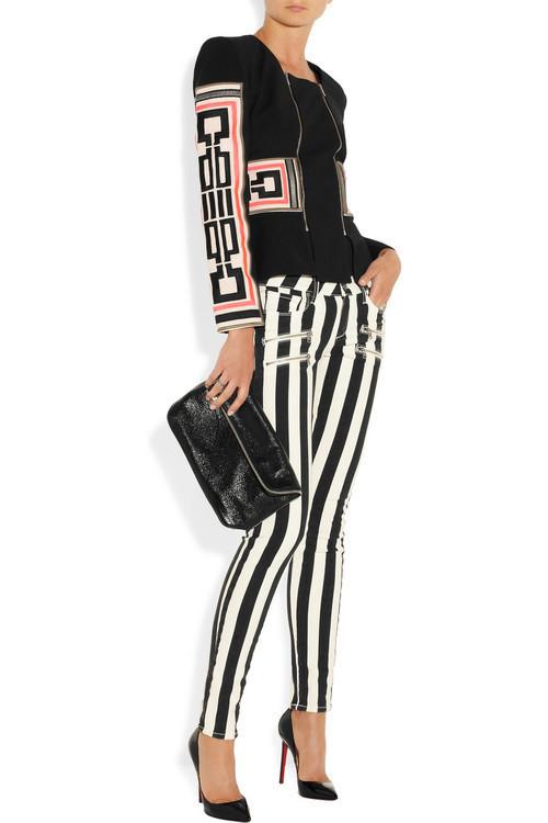 Jacket by Sass & Bide, Paige jeans, Rochas clutch, Christian Louboutin pumps, Bottega Veneta and Kenneth Jay Lane rings.