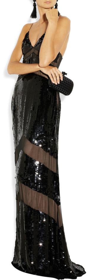 Gown by Emilio Pucci, earrings by Oscar De La Renta, clutch by Bottega Veneta and ring by Lanvin.