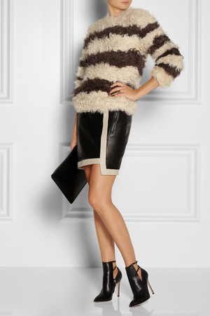 Knit by Thakoon, skirt by Helmut Lang, booties by Gianvito Rossi, clutch by Jil Sander and ring by Eddie Borgo.