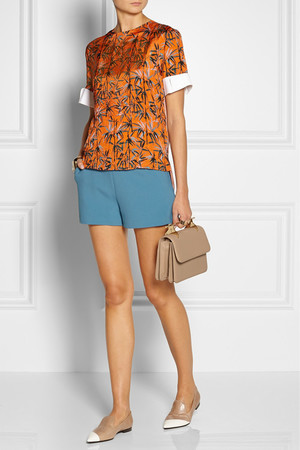 Top and shorts by Carven, bag by Maiyet, shoes by Miu Miu, rings by Maison Martin Margiela and bracelet by Chloe.