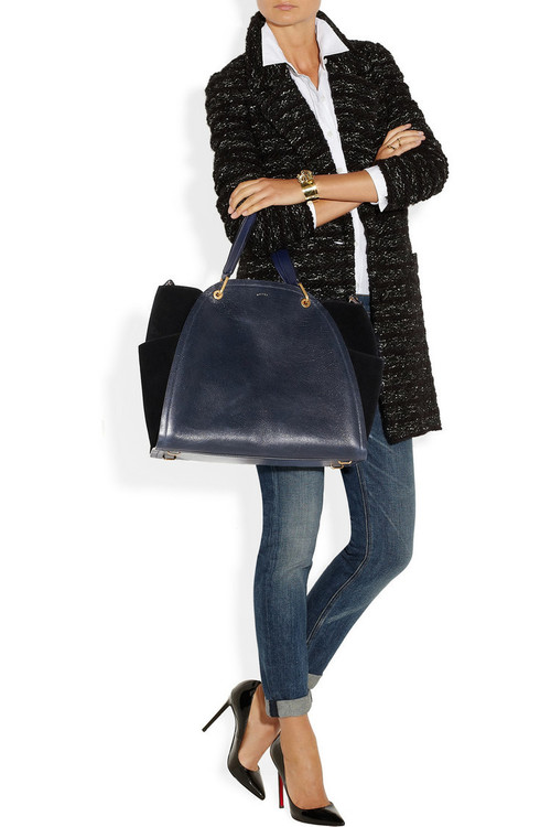 Coat by Isabel Marant, shirt by Theory, jeans by Rag & Bone, bag and ring by Maiyet, pumps by Christian Louboutin and bracelet by Chloe.