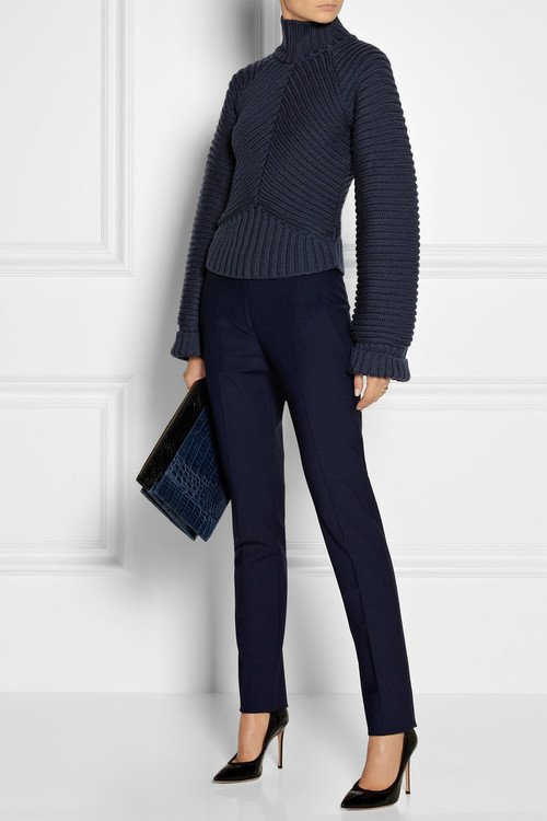 Knit, pants and clutch by Roland Mouret and shoes by Gianvito Rossi.