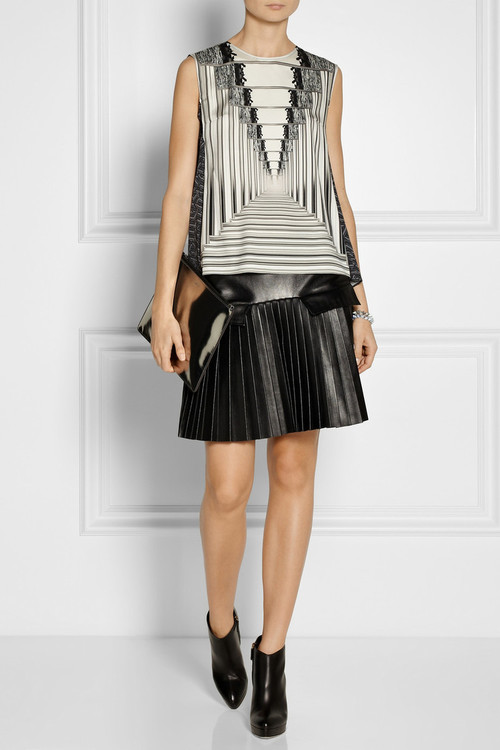 Shirt by Peter Pilotto, skirt by Les Chiffoniers, boots by Gucci, clutch by Jil Sander, bracelets by Eddie Borgo.