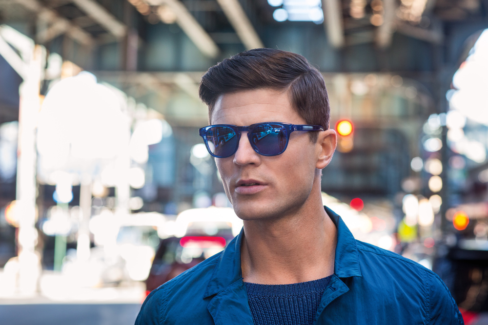 Blake Kuchta   (New York Models)  wears sunglasses by Ross & Brown, sweater by Paper Denim & Cloth and jacket by Stone Island.