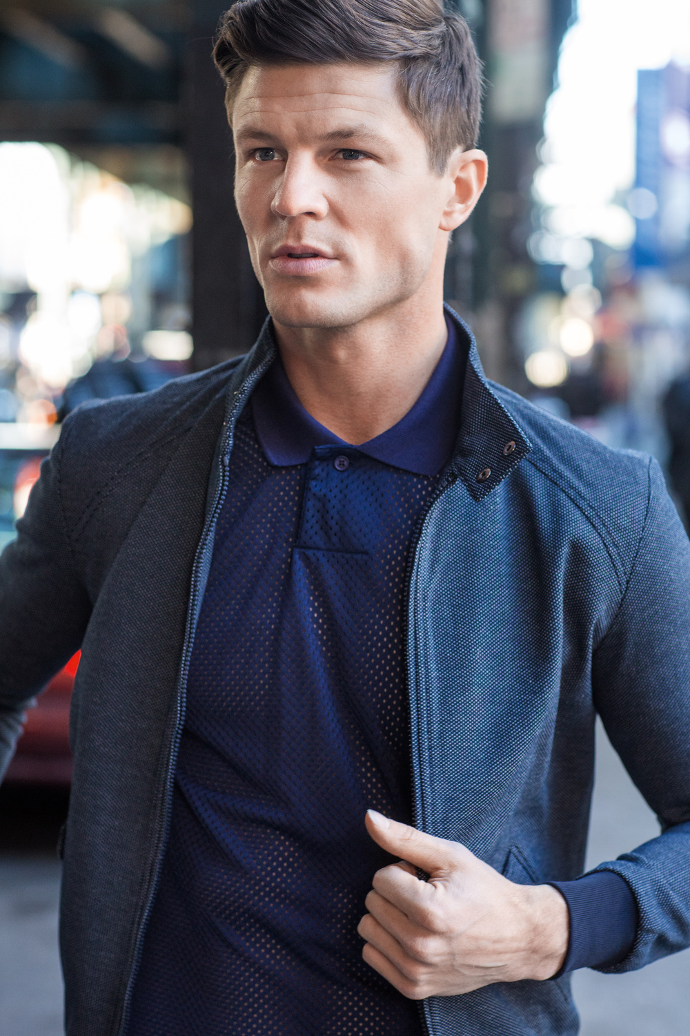 Blake Kuchta     (New York Models)  wears a jacket by Zara and mesh polo shirt by Lacoste.