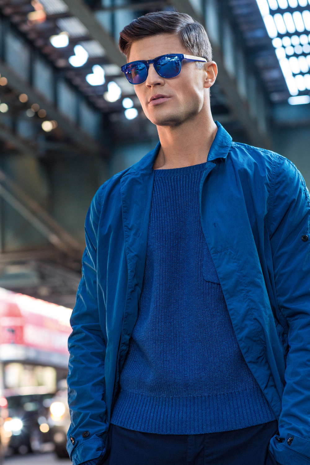 Blake Kuchta   (New York Models)  wears sunglasses by Ross & Brown, sweater by Paper Denim & Cloth and jacket and shorts by Stone Island.