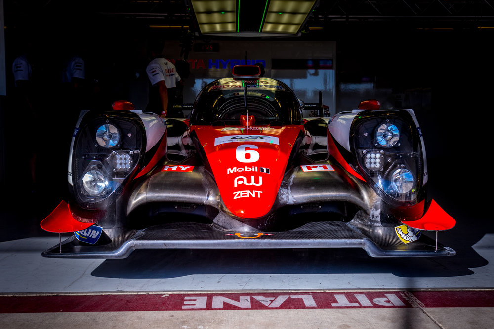 No. 6 Toyota Gazoo Racing - Toyota TS050 Hybrid lurking in the shadows of its FIA WEC pit lane garage at Circuit of the Americas