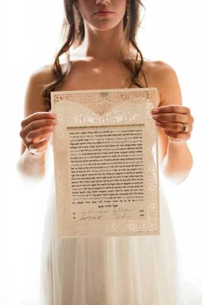 Bride holding Orchards Ketubah