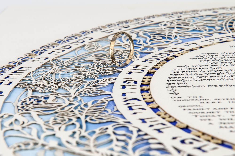 Jewish wedding ring on Ketubah