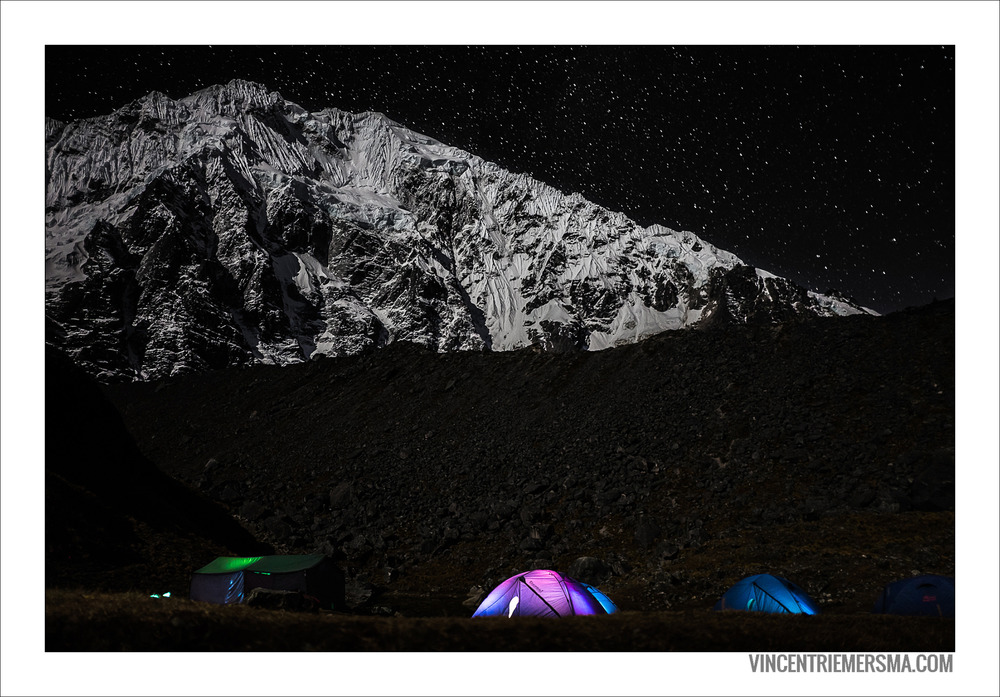 Torchlit tents on the foot of Salkantay mountain