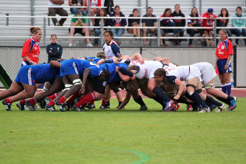 Scrum during the USA-France series in California. (That's me standing by the scrum. I'm a scrumhalf, which basically means I'm the little one, who yells at the big ones, pictured here beating the crap out of each other.)