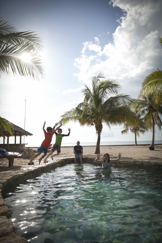 Oscar and Elliott jumping into pool128.jpeg