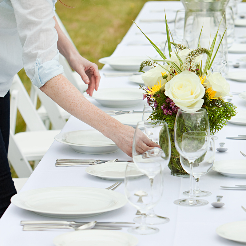 Wedding Planner setting up for a reception.jpg