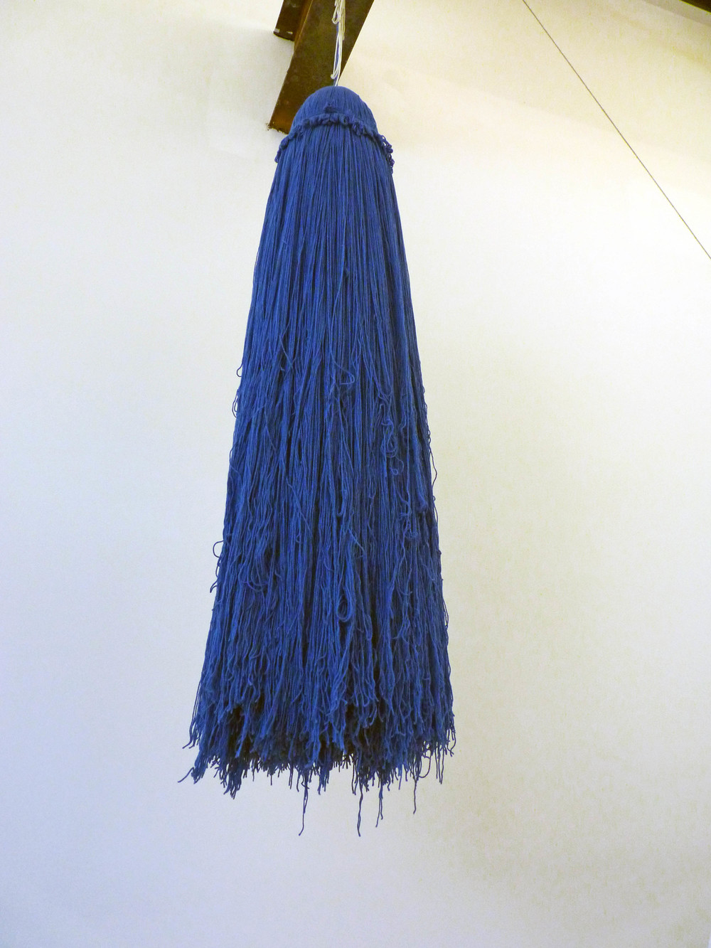 Denim Burka Tassel, 2005-2015, 25 pounds of acrylic yarn, beads and rope with hook, 7' with rope dimensions variable, Detail from Pleasures of the Flesh, 2015