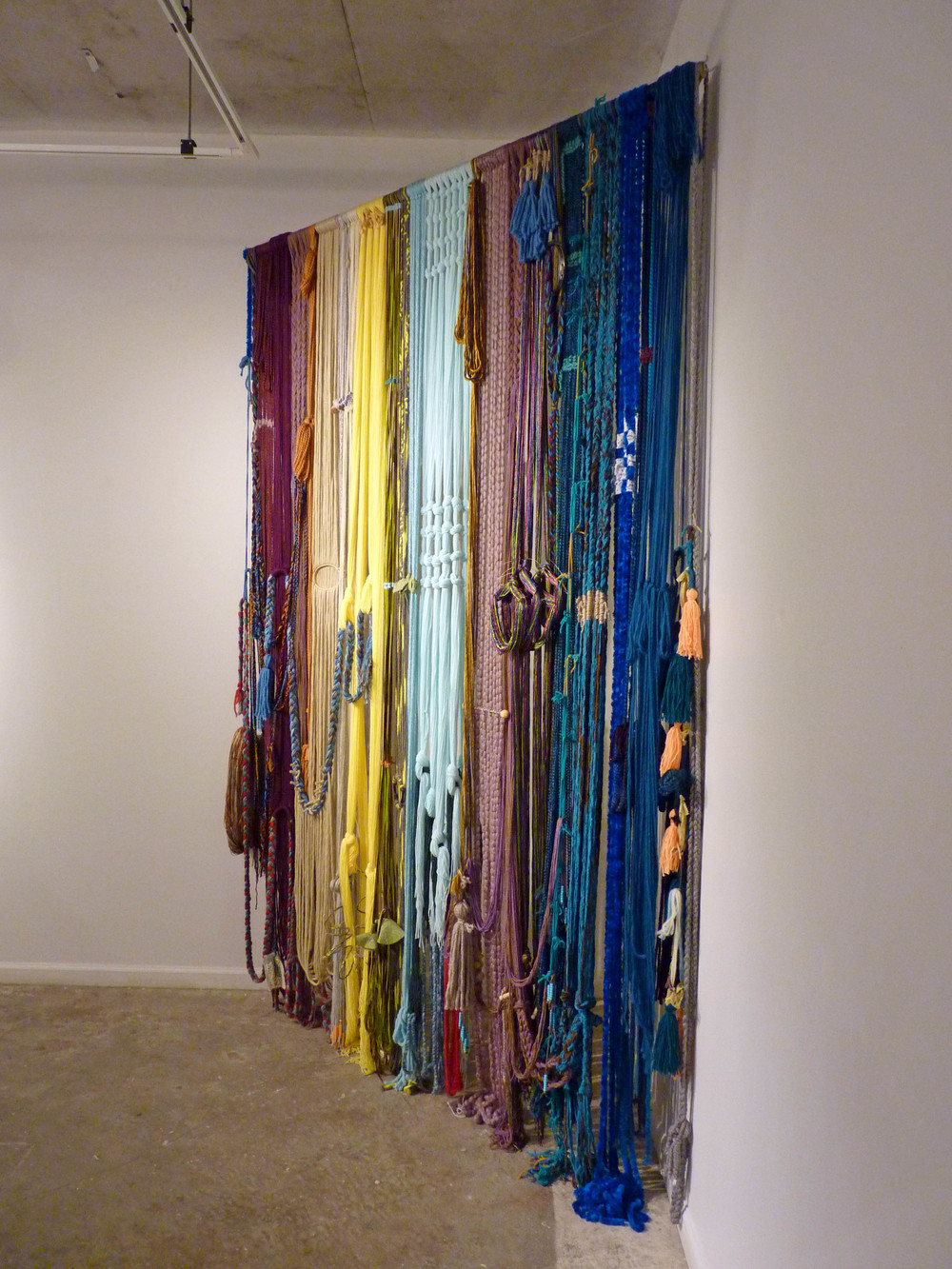 Teen Baleen (Corset), 2015, Yarn with fabric, wood and metal, 7' x 4' x 11'