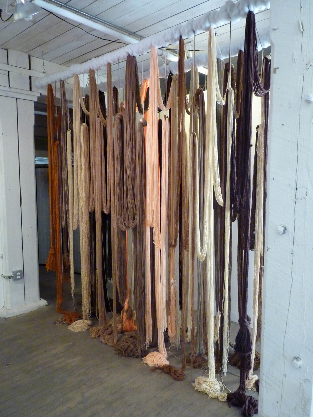 A Valence, 2012, Yarn, wood, poly-fil and hardware, 10 x 2 x 10 feet