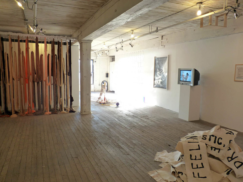 A Valence, 2012, Yarn, wood, poly-fil and hardware, 10 x 2 x 10 feet (Installation view)