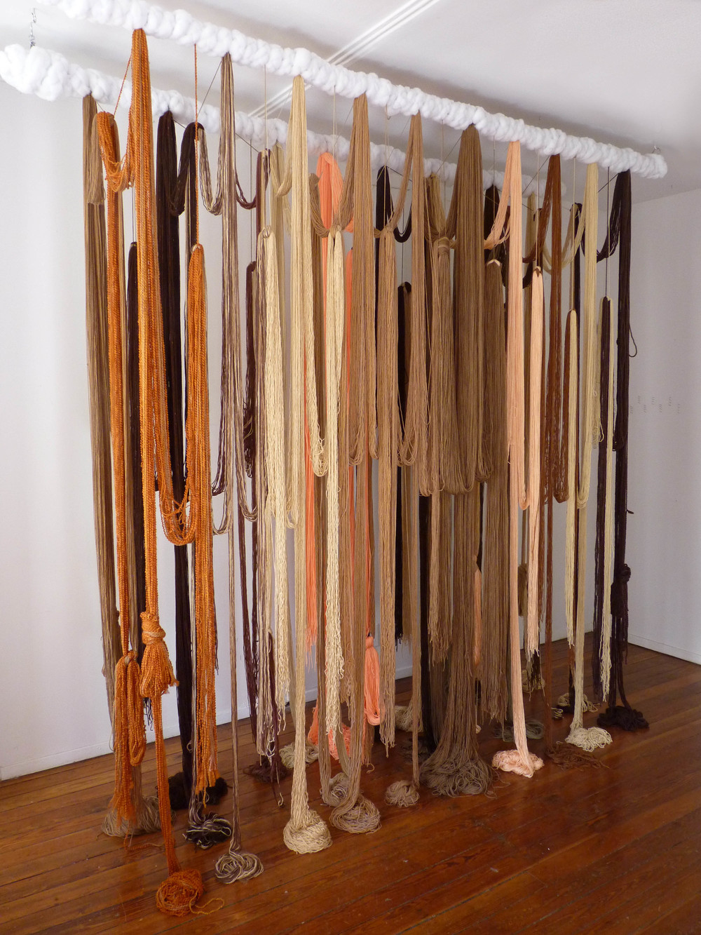 A Valence, 2012, Yarn, wood, poly-fil and hardware, 10 x 2 x 10 feet (Studio view)