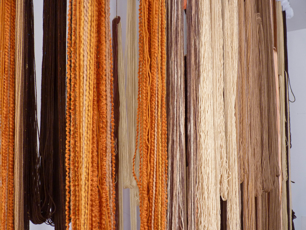 A Valence, 2012, Yarn, wood, poly-fil and hardware, 10 x 2 x 10 feet (Studio view detail)